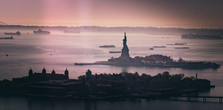 silhouette of statue of liberty during sunset